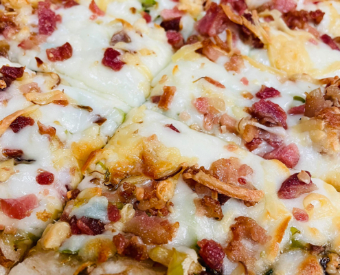 Frozen take-n-bake Brussels and Bacon Pizza - QC Pizza Mahtomedi MN.