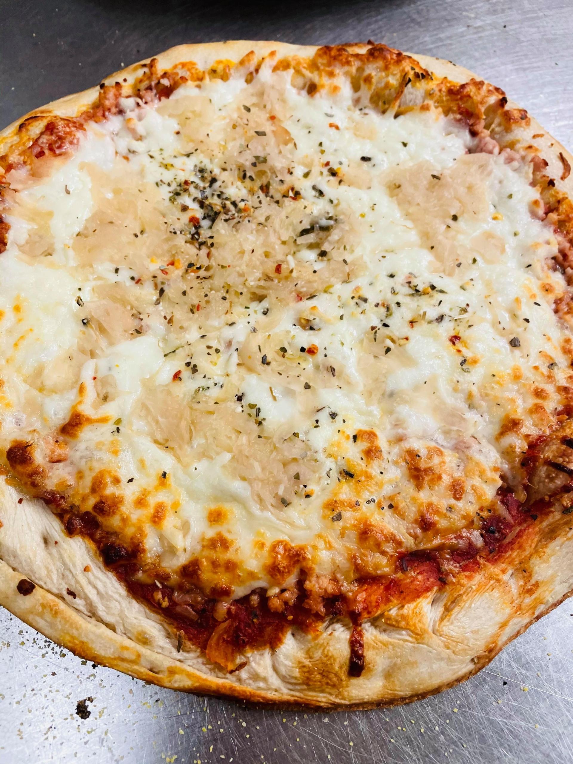 Frozen take-n-bake Sour Pig Pizza - QC Pizza Mahtomedi MN.